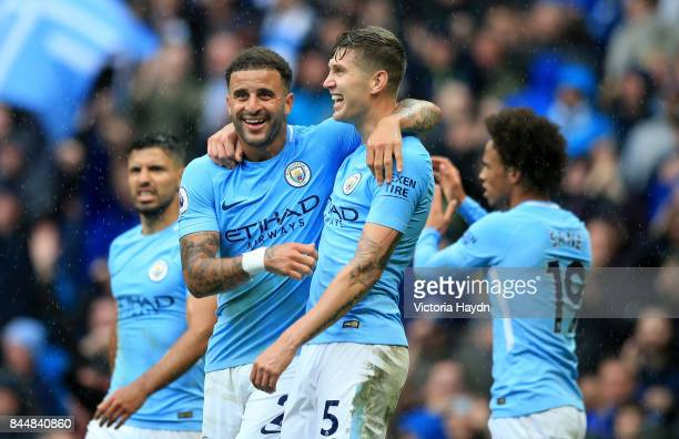 Kyle Walker of Manchester City and John Stones of Manchester City celebrate victory together after the Premier League match between Manchester City...