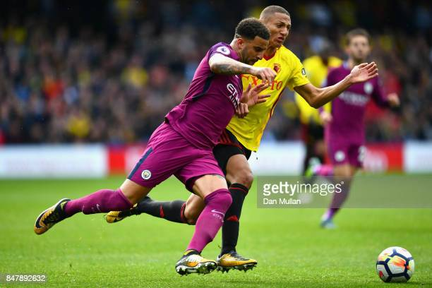 Kyle Walker of Manchester City and Richarlison de Andrade of Watford battle for possession during the Premier League match between Watford and...