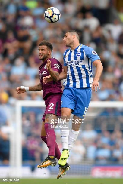 Kyle Walker of Manchester City and Tomer Hemed of Brighton and Hove Albion battle for possession in the air during the Premier League match between...