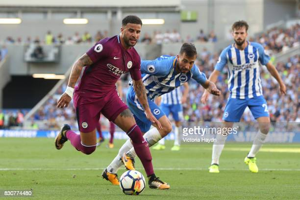 Kyle Walker of Manchester City attempts to get past Shane Duffy of Brighton and Hove Albion during the Premier League match between Brighton and Hove...