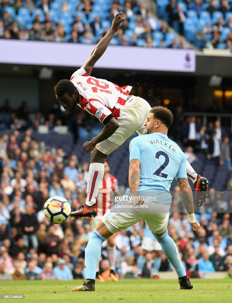 Kyle Walker of Manchester City deflectes Mame Biram Diouf of Stoke City header into the net to for a own goal during the Premier League match between Manchester City and Stoke City at Etihad Stadium on October 14, 2017 in Manchester, England.