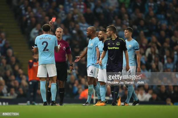 Kyle Walker of Manchester City gets a red card on his home debut during the Premier League match between Manchester City and Everton at Etihad...
