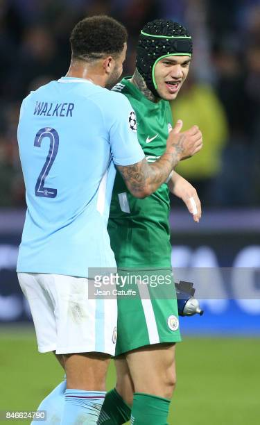 Kyle Walker of Manchester City greets goalkeeper of Manchester City Ederson Moraes following the UEFA Champions League match between Feyenoord...