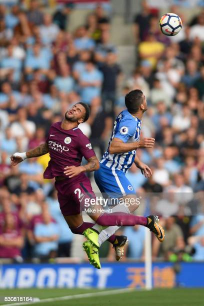 Kyle Walker of Manchester City is challenged by Tomer Hemed of Brighton during the Premier League match between Brighton and Hove Albion and...