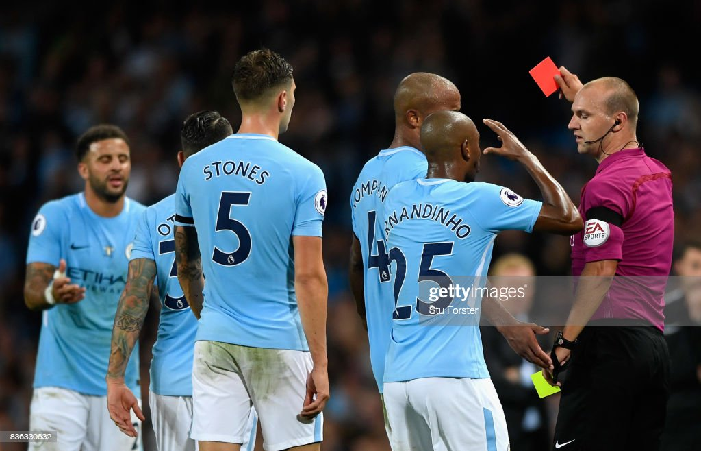 Kyle Walker of Manchester City (L) is shown a second yellow card leading to being sent off during the Premier League match between Manchester City and Everton at Etihad Stadium on August 21, 2017 in Manchester, England.
