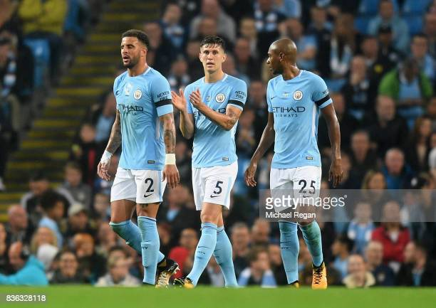 Kyle Walker of Manchester City John Stones of Manchester City Fernandinho of Manchester City look dejected after Everton score during the Premier...