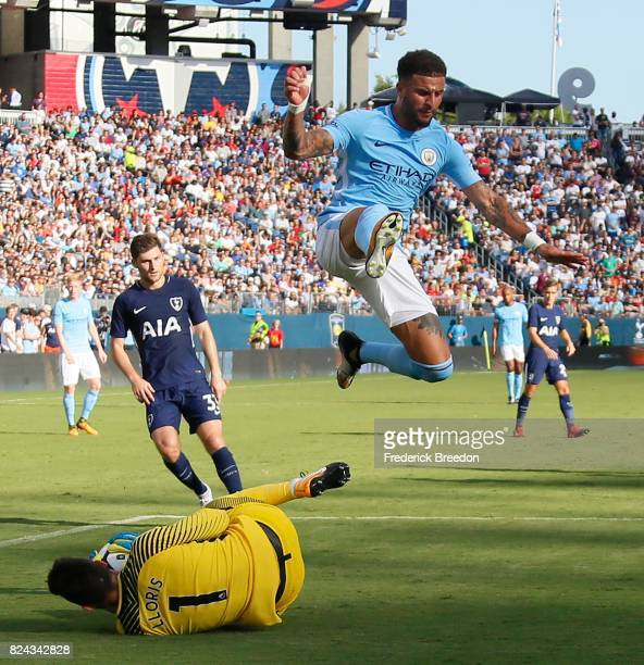 Kyle Walker of Manchester City jumps over goaltender Hugo Lloris of Tottenham during the first half of the 2017 International Champions Cup Presented...