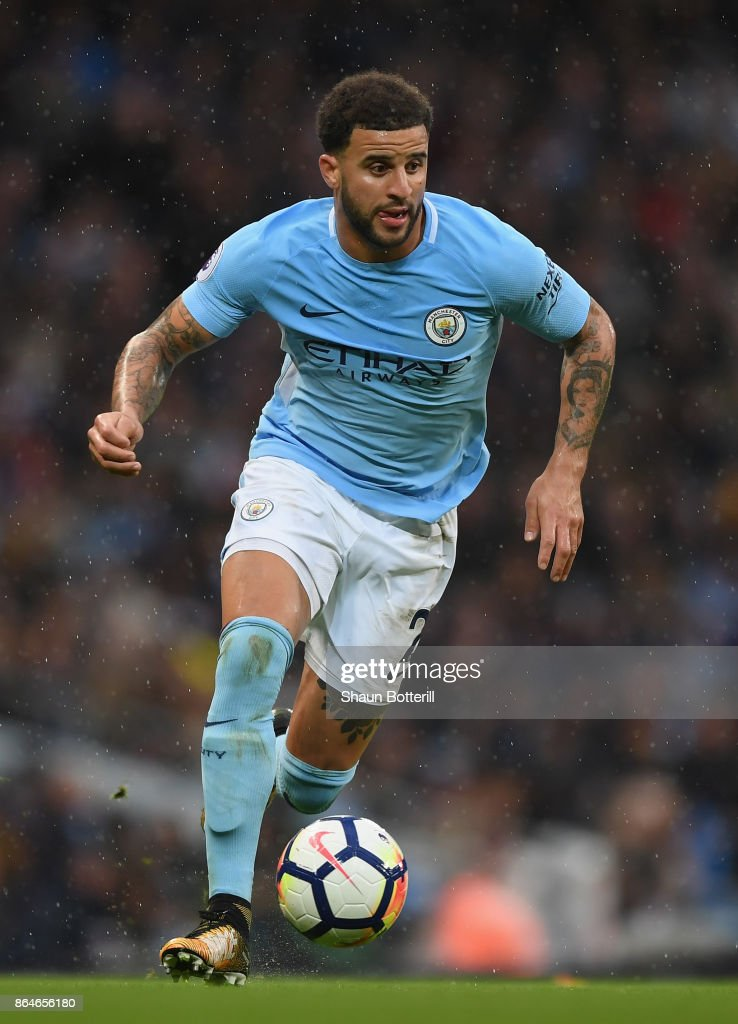 Kyle Walker of Manchester City runs with the ball during the Premier League match between Manchester City and Burnley at Etihad Stadium on October 21, 2017 in Manchester, England.