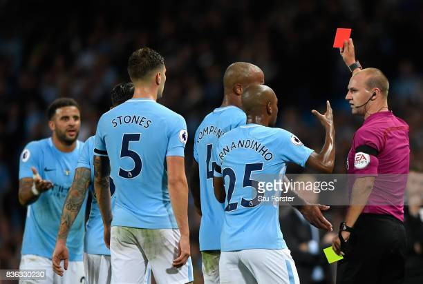 Kyle Walker of Manchester City us shown a second yellow card leading to being sent off during the Premier League match between Manchester City and...