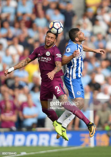 Kyle Walker of Mancheter City and Tomer Hemed of Brighton and Hove Albion battle for possession in the air during the Premier League match between...