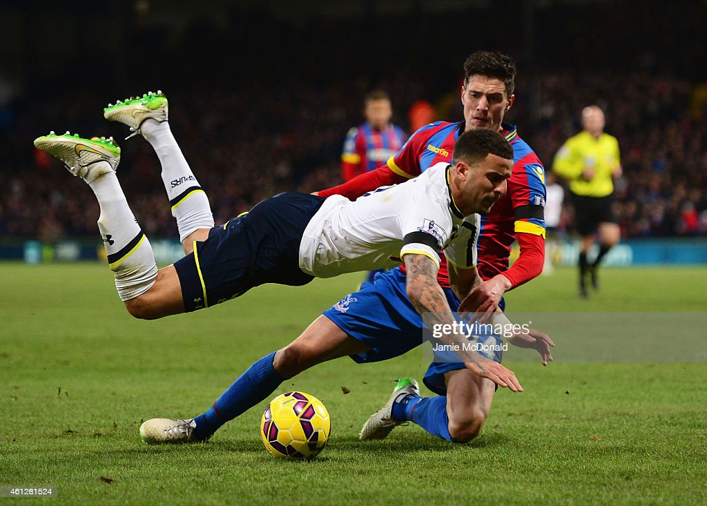 Kyle Walker of Spurs is tackled by Martin Kelly of Crystal Palace during the Barclays Premier League match between Crystal Palace and Tottenham Hotspur at Selhurst Park on January 10, 2015 in London, England.