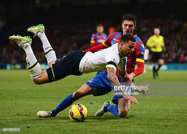Kyle Walker of Spurs is tackled by Martin Kelly of Crystal Palace during the Barclays Premier League match between Crystal Palace and Tottenham...