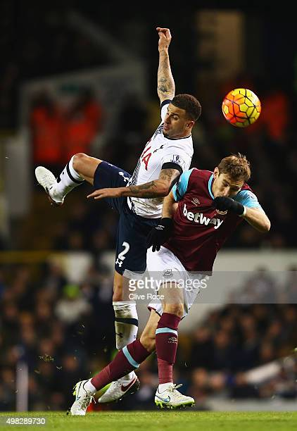 Kyle Walker of Tottenham Hotspur challenges for the ball with Nikica Jelavic of West Ham United during the Barclays Premier League match between...