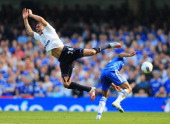 Kyle Walker of Tottenham Hotspur is challenged by Ashley Cole of Chelsea during the Barclays Premier League match between Chelsea and Tottenham...