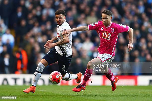 Kyle Walker of Tottenham Hotspur is chased by Marc Pugh of Bournemouth during the Barclays Premier League match between Tottenham Hotspur and AFC...