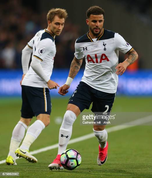 Kyle Walker of Tottenham Hotspur is watched by Christian Eriksen of Tottenham Hotspur during the Premier League match between West Ham United and...