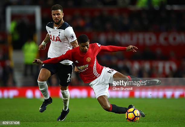 Kyle Walker of Tottenham Hotspur pulls the shirt of Marcus Rashford of Manchester United resulting in an yellow card during the Premier League match...