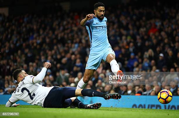 Kyle Walker of Tottenham Hotspur tackles Gael Clichy of Manchester City during the Premier League match between Manchester City and Tottenham Hotspur...
