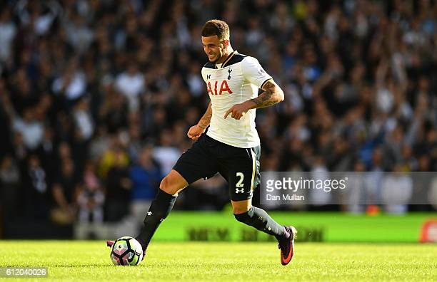 Kyle Walker of Tottenham Hotspur takes the ball forward during the Premier League match between Tottenham Hotspur and Manchester City at White Hart...