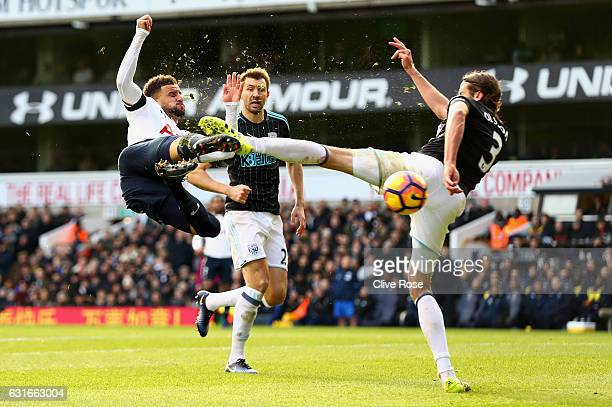 Kyle Walker of Tottenham Hotspur volleys while Jonas Olsson of West Bromwich Albion attempts to block during the Premier League match between...