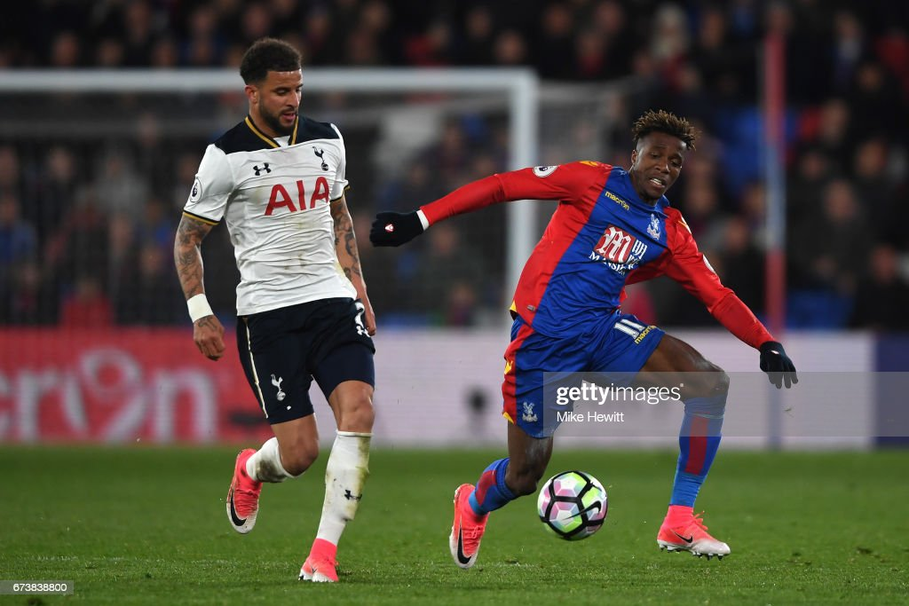 Kyle Walker of Tottenham tangles with Wilfried Zaha of Crystal Palace during the Premier League match between Crystal Palace and Tottenham Hotspur at Selhurst Park on April 26, 2017 in London, England.