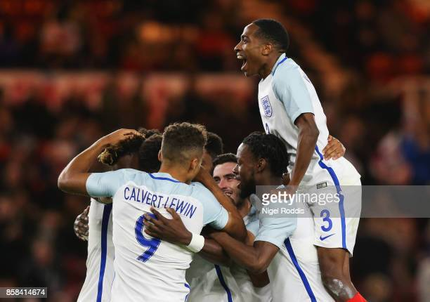 Kyle WalkerPeters of England and team mates congratulate Tammy Abraham of England as he scores their second goal from a penalty during the UEFA...