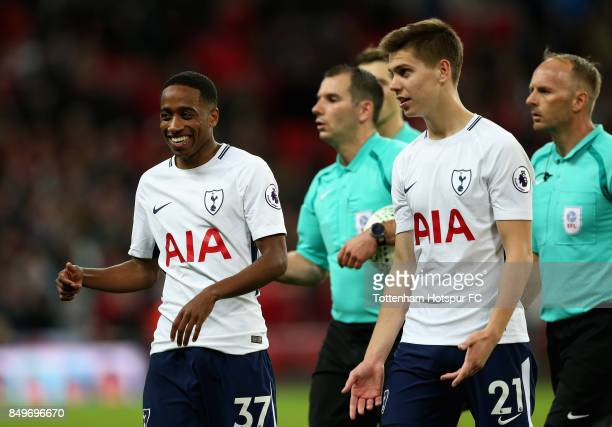 Kyle WalkerPeters of Tottenham Hotspur and Juan Foyth of Tottenham Hotspur speak to each other after the Carabao Cup Third Round match between...