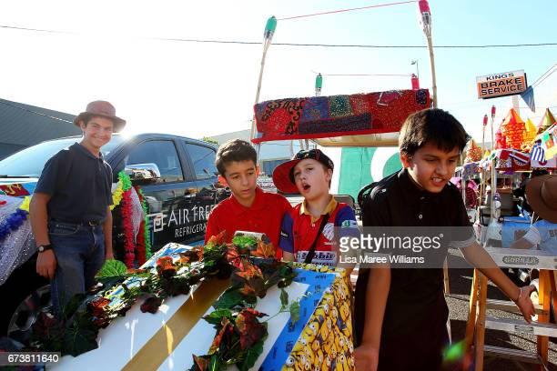 Kyle Warner Mani Mirzamohannati Joseph Doody and Jasmeet Singhunsa help to prepare floats on Peel Street on January 28 2017 in Tamworth Australia...