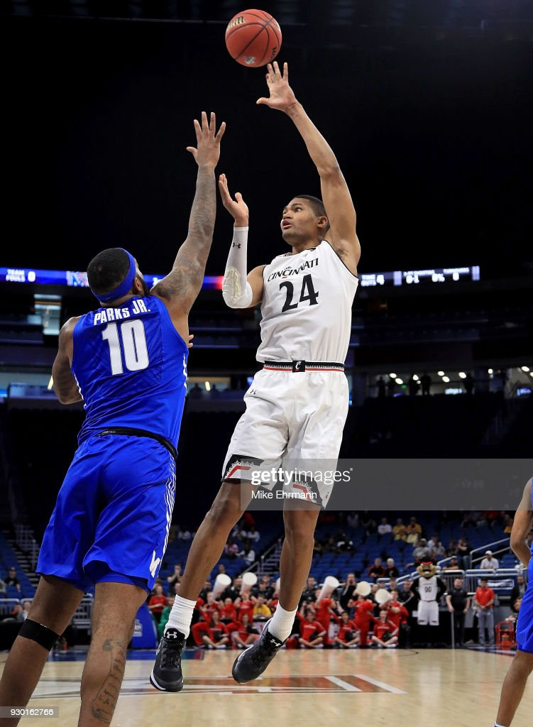 Kyle Washington #24 of the Cincinnati Bearcats shoots over Mike Parks Jr. #10 of the Memphis Tigers during a semifinal game of the 2018 AAC Basketball Championship at Amway Center on March 10, 2018 in Orlando, Florida.