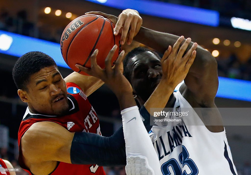 Kyle Washington #32 of the North Carolina State Wolfpack and <a gi-track='captionPersonalityLinkClicked' href=/galleries/search?phrase=Daniel+Ochefu&family=editorial&specificpeople=9986325 ng-click='$event.stopPropagation()'>Daniel Ochefu</a> #23 of the Villanova Wildcats go after the ball in the first half during the third round of the 2015 NCAA Men's Basketball Tournament at Consol Energy Center on March 21, 2015 in Pittsburgh, Pennsylvania.