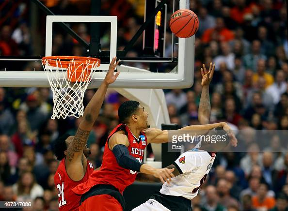 Kyle Washington of the North Carolina State Wolfpack fouls Terry Rozier of the Louisville Cardinals in the second half of the game during the East...