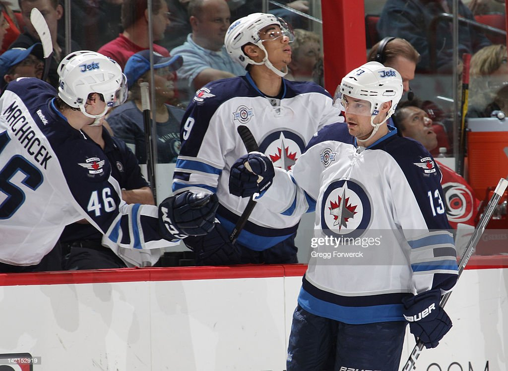 <a gi-track='captionPersonalityLinkClicked' href=/galleries/search?phrase=Kyle+Wellwood&family=editorial&specificpeople=577984 ng-click='$event.stopPropagation()'>Kyle Wellwood</a> #13 of the Winnipeg Jets celebrates his game tying goal against the Carolina Hurricanes during an NHL game on March 30, 2012 at PNC Arena in Raleigh, North Carolina.
