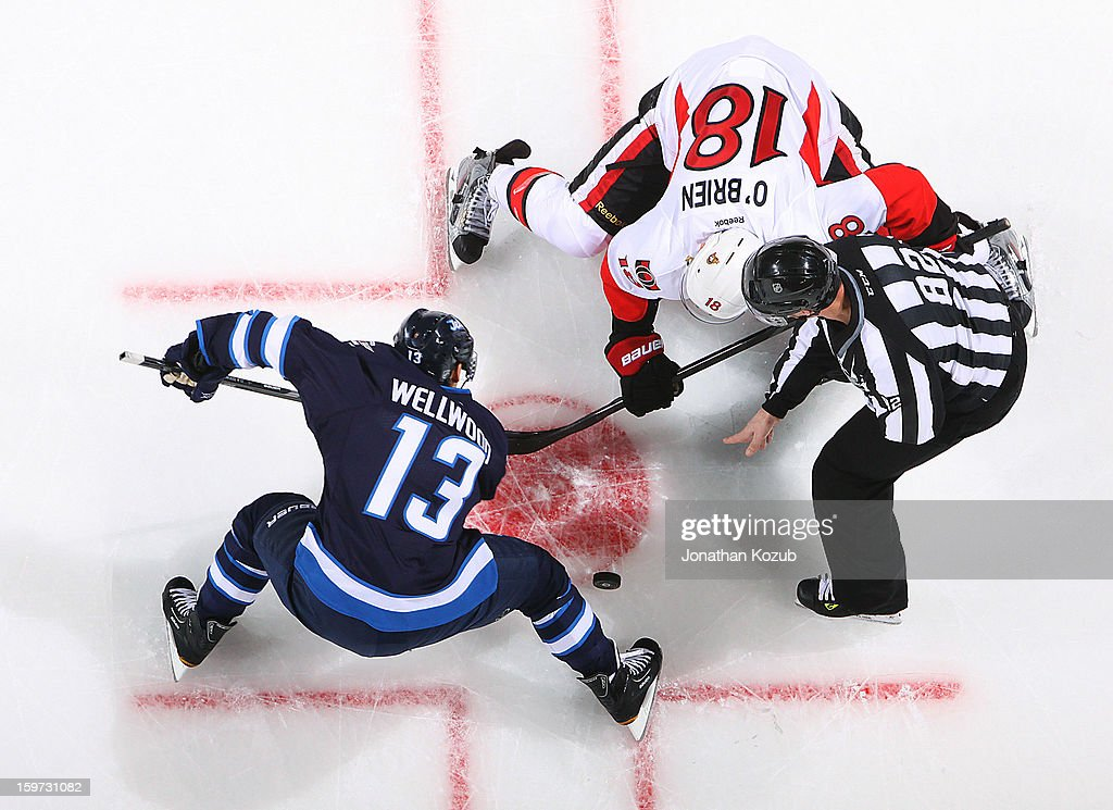 Kyle Wellwood of the Winnipeg Jets wins a second period faceoff against Jim O'Brien of the Ottawa Senators at the MTS Centre on January 19 2013 in...