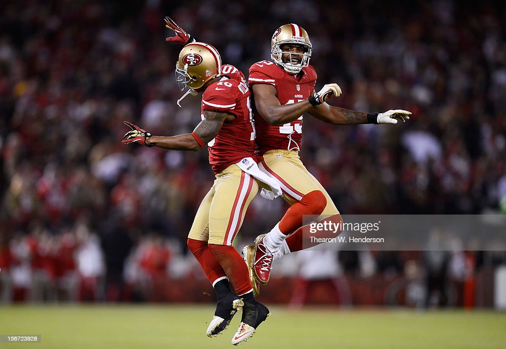 Kyle Williams #10 and Michael Crabtree #15 of the San Francisco 49ers celebrate a reception by Williams in the first quarter of the game against the Chicago Bears at Candlestick Park on November 19, 2012 in San Francisco, California.