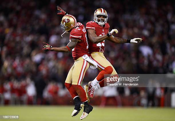 Kyle Williams and Michael Crabtree of the San Francisco 49ers celebrate a reception by Williams in the first quarter of the game against the Chicago...