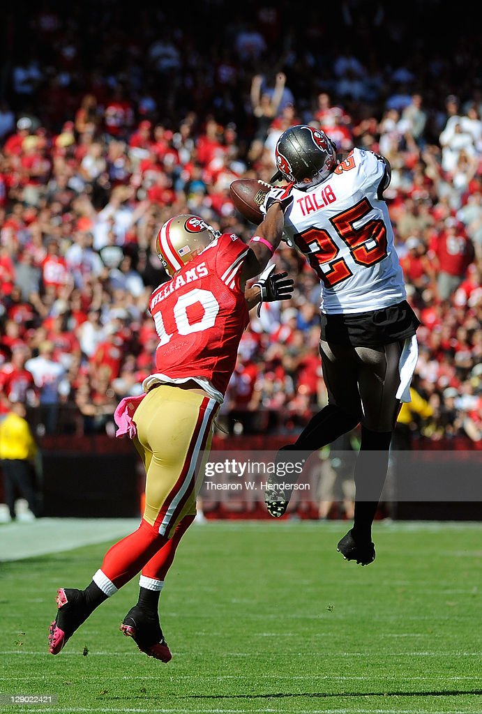 Kyle Williams #10 of the San Francisco 49ers keeps Aqib Talib #25 of the Tampa Bay Buccaneers from intercepting this pass in the third quarter during an NFL football game at Candlestick Park on October 9, 2011 in San Francisco, California. The 49ers won the game 48-3.