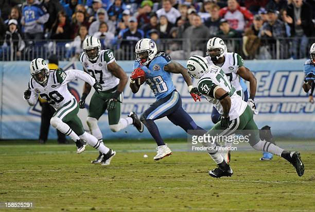 Kyle Wilson Calvin Pace and Yeremiah Bell of the New York Jets chase running back Chris Johnson of the Tennessee Titans as he carries the ball for a...