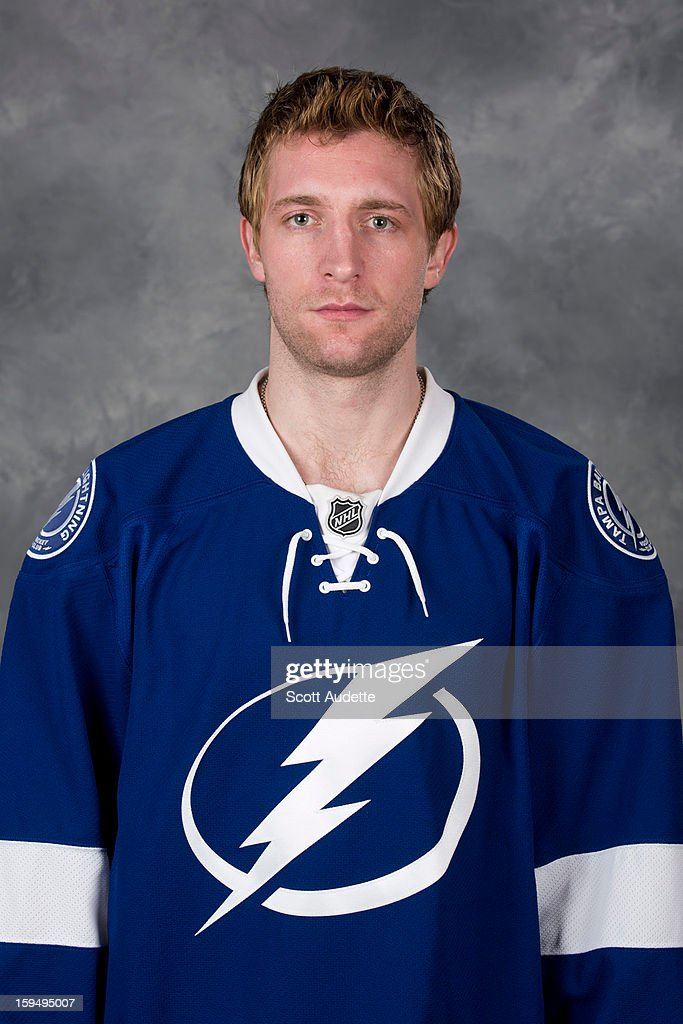 Kyle Wilson of the Tampa Bay Lightning poses for his official headshot for the 2012-2013 season at the Tampa Bay Times Forum on January 13, 2013 in Tampa, Florida.