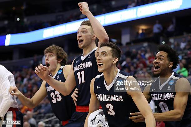 Kyle Wiltjer Domantas Sabonis Kyle Dranginis and Silas Melson of the Gonzaga Bulldogs celebrate from the bench late in the second half against the...