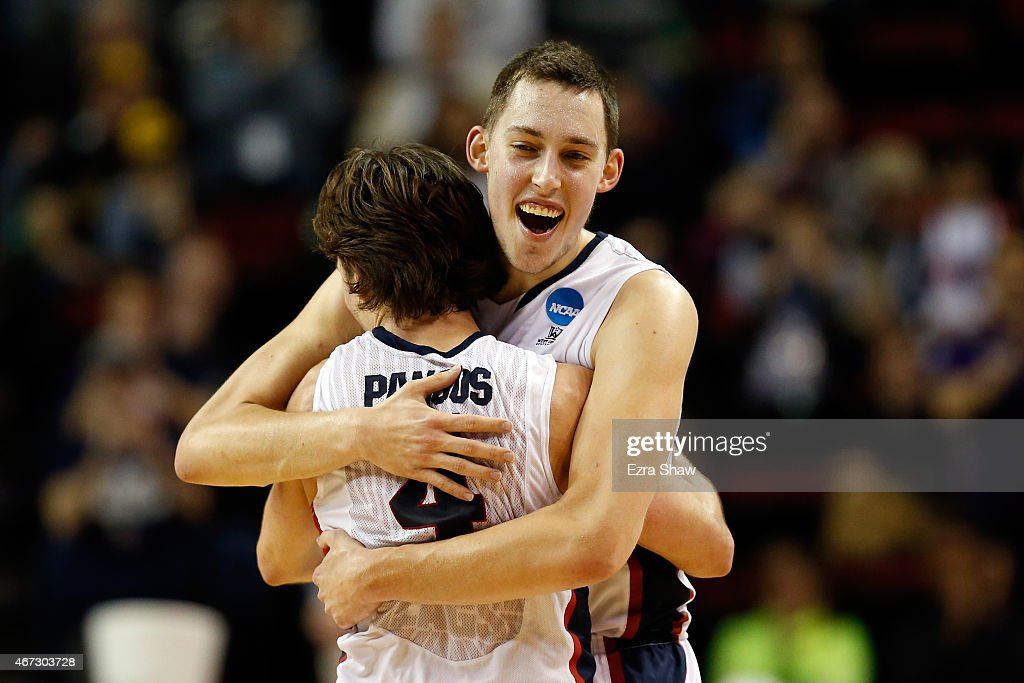<a gi-track='captionPersonalityLinkClicked' href=/galleries/search?phrase=Kyle+Wiltjer&family=editorial&specificpeople=7621176 ng-click='$event.stopPropagation()'>Kyle Wiltjer</a> #33 of the Gonzaga Bulldogs celebrates with Kevin Pangos #4 after defeating the Iowa Hawkeyes 87 to 68 during the third round of the 2015 NCAA Men's Basketball Tournament at KeyArena on March 22, 2015 in Seattle, Washington.