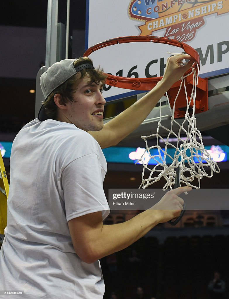 Kyle Wiltjer #33 of the Gonzaga Bulldogs cuts a piece of a net after defeating the Saint Mary's Gaels 85-75 to win the championship game of the West Coast Conference Basketball tournament at the Orleans Arena on March 8, 2016 in Las Vegas, Nevada.