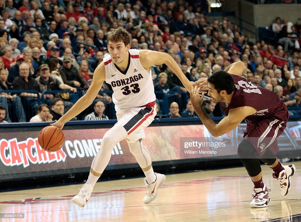 Kyle Wiltjer #33 of the Gonzaga Bulldogs drives against Martin Breunig #12 of the Montana Grizzlies during the second half of the game at McCarthey Athletic Center on December 8, 2015 in Spokane, Washington. Gonzaga defeated Montana 61-58.