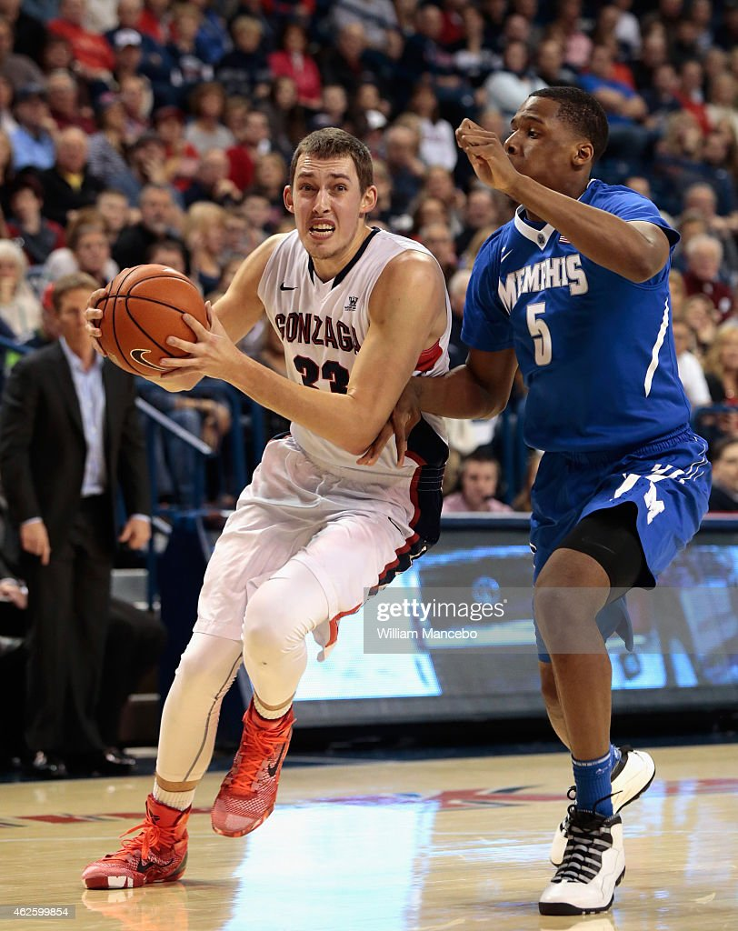 <a gi-track='captionPersonalityLinkClicked' href=/galleries/search?phrase=Kyle+Wiltjer&family=editorial&specificpeople=7621176 ng-click='$event.stopPropagation()'>Kyle Wiltjer</a> #33 of the Gonzaga Bulldogs drives against <a gi-track='captionPersonalityLinkClicked' href=/galleries/search?phrase=Nick+King+-+Basketball+Player&family=editorial&specificpeople=14512053 ng-click='$event.stopPropagation()'>Nick King</a> #5 of the Memphis Tigers in the second half at McCarthey Athletic Center on January 31, 2015 in Spokane, Washington. Gonzaga defeated Memphis 82-64.