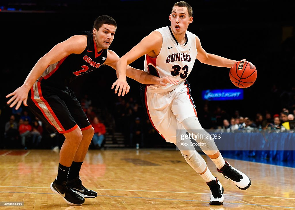 Kyle Wiltjer #33 of the Gonzaga Bulldogs drives past Houston Kessler #24 of the Georgia Bulldogs in the first half at Madison Square Garden on November 26, 2014 in New York City.