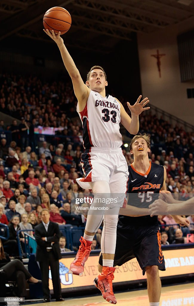 <a gi-track='captionPersonalityLinkClicked' href=/galleries/search?phrase=Kyle+Wiltjer&family=editorial&specificpeople=7621176 ng-click='$event.stopPropagation()'>Kyle Wiltjer</a> #33 of the Gonzaga Bulldogs goes up for a goal in front of defender Jett Raines #45 of the Pepperdine Waves in the second half at McCarthey Athletic Center on February 14, 2015 in Spokane, Washington. Gonzaga defeated Pepperdine 56-48.