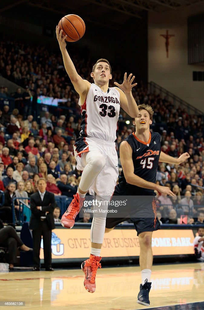 Kyle Wiltjer #33 of the Gonzaga Bulldogs goes up for a goal in front of defender Jett Raines #45 of the Pepperdine Waves in the second half at McCarthey Athletic Center on February 14, 2015 in Spokane, Washington. Gonzaga defeated Pepperdine 56-48.