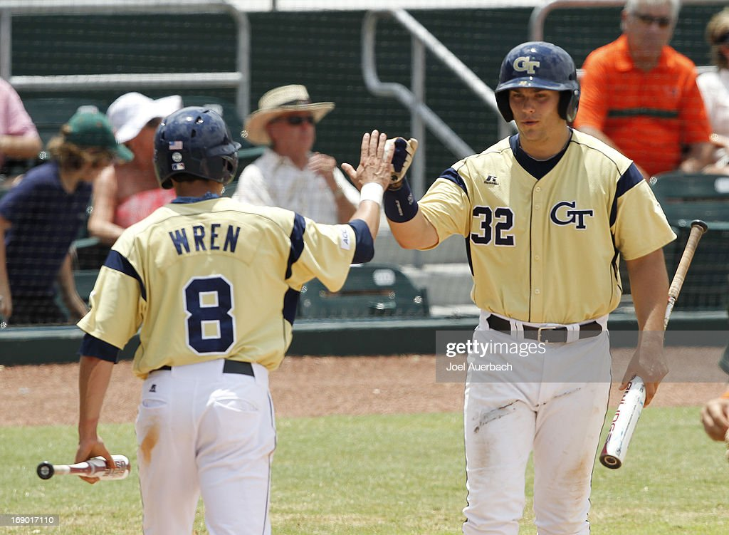 Kyle Wren #8 is congratulated by Daniel Palka #32 after scoring on a hit by Zane Evans #10 (not pictured) of the Georgia Tech Yellow Jackets in fifth inning action against the Miami Hurricanes on May 18, 2013 at Alex Rodriguez Park at Mark Light Field in Coral Gables, Florida. Georgia Tech defeated Miami 10-1.
