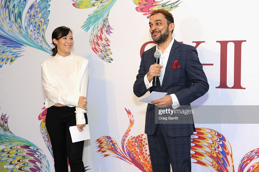 Kylene Campos (L) and Sandeep Seth speak to guests during the K-II #ChangeDestiny Holiday Essence Launch Party on November 17, 2016 in New York City.