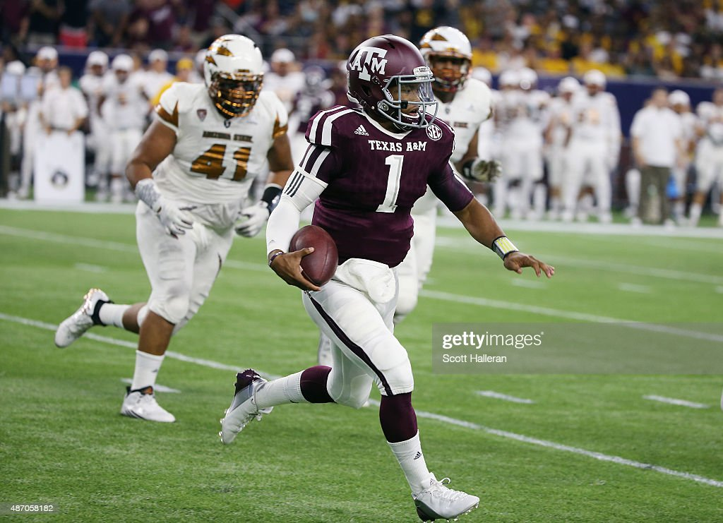 Kyler Murray of the Texas AM Aggies runs upfield in the first half of their game against the Arizona State Sun Devils during the Advocare Texas...