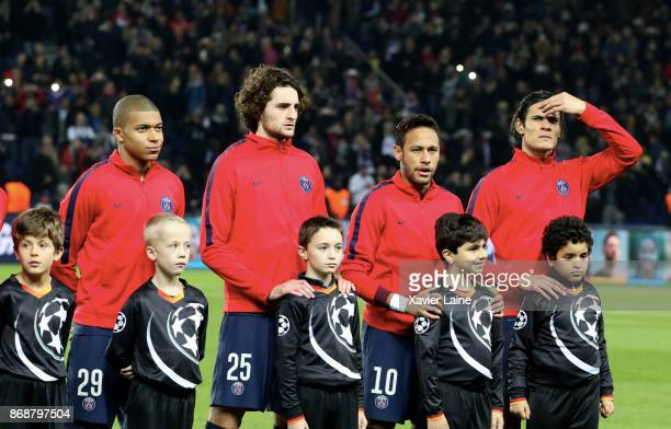 Kylian Mbappe Adrien Rabiot Neymar Jr and Edinson Cavani of Paris SaintGermain pose before the UEFA Champions League group B match between Paris...
